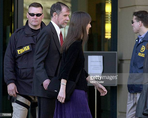 Marilyn Walker and Frank Lindh the mother and father of American Taliban John Walker Lindh pass by heavy security as they depart for a lunch break at...