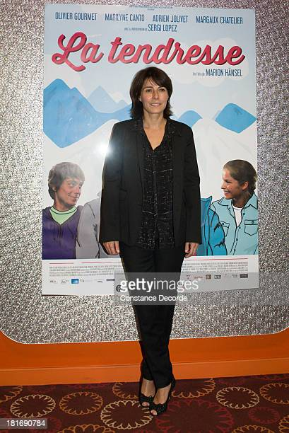 Marilyne Canto posing at La Tendresse Premiere on September 23 2013 in Paris France