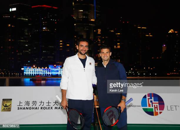 Marin Cilic and Grigor Dimitrov pose for a picture at roof top of Fosun Foundation at the Bund on Day 2 of 2017 ATP 1000 Shanghai Rolex Masters on...