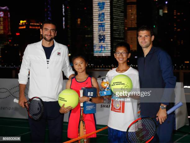 Marin Cilic and Grigor Dimitrov pose for a picture with some children after their minitournament at Fosun Foundation at the Bund on Day 2 of 2017 ATP...