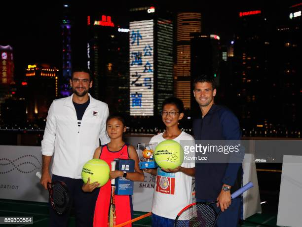 Marin Cilic and Grigor Dimitrov pose for a picture with the some children after their minitournament at Fosun Foundation at the Bund on Day 2 of 2017...