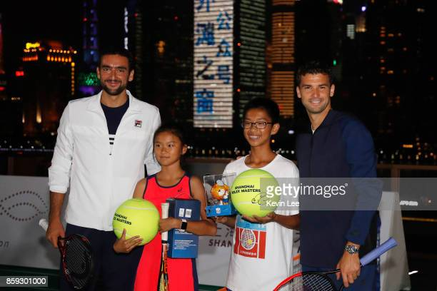 Marin Cilic and Grigor Dimitrov poses for a picture with soem children after their minitournament at Fosun Foundation at the Bund on Day 2 of 2017...