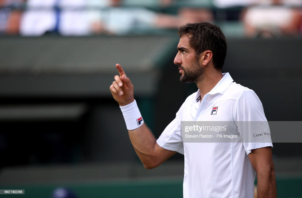 Marin Cilic in action on court one on day four of the Wimbledon Championships at the All England Lawn Tennis and Croquet Club, Wimbledon