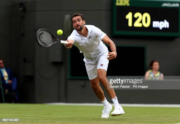 Marin Cilic in action on day four of the Wimbledon Championships at the All England Lawn Tennis and Croquet Club Wimbledon
