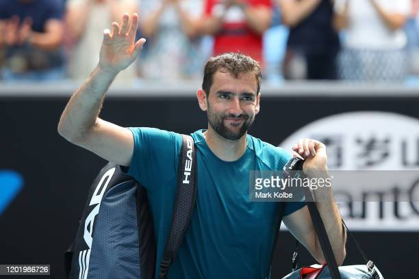 Marin Cilic of Croatia acknowledges the crowd after defeat in his Men's Singles fourth round match against Milos Raonic of Canada on day seven of the...