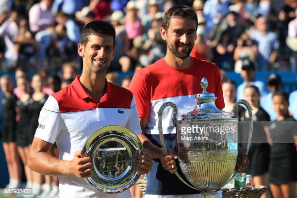 Marin Cilic of Croatia and Novak Djokovic of Serbia pose after Day 7 of the FeverTree Championships at Queens Club on June 24 2018 in London United...