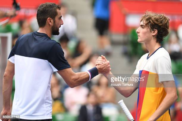Marin Cilic of Croatia and Stefanos Tsitsipas of Greece shake hands after their match during day one of the Rakuten Open at Ariake Coliseum on...