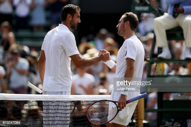 Marin Cilic of Croatia and Steve Johnson of The United States shake hands after the Gentlemen's Singles third round match against Steve Johnson of...