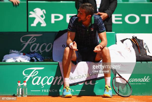 Marin Cilic of Croatia argues with the chair umpire during his three set defeat by Albert RamosVinolas of Spain in their quarter final round match on...