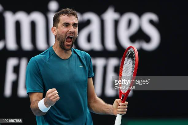 Marin Cilic of Croatia celebrates after winning a point during his Men's Singles third round match against Roberto Bautista Agut of Spain on day five...