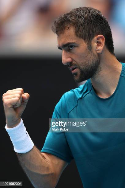 Marin Cilic of Croatia celebrates after winning a point during his Men's Singles fourth round match against Milos Raonic of Canada on day seven of...