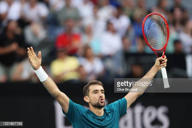 Marin Cilic of Croatia celebrates after winning match point during his Men's Singles third round match against Roberto Bautista Agut of Spain on day...