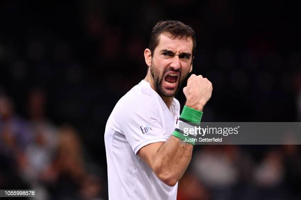 Marin Cilic of Croatia celebrates after winning match point in his Round of 16 match against Grigor Dimitrov of Bulgaria during Day Four of the Rolex...