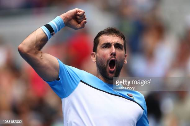 Marin Cilic of Croatia celebrates after winning match point in his second round match against Mackenzie Mcdonald of the United States during day...