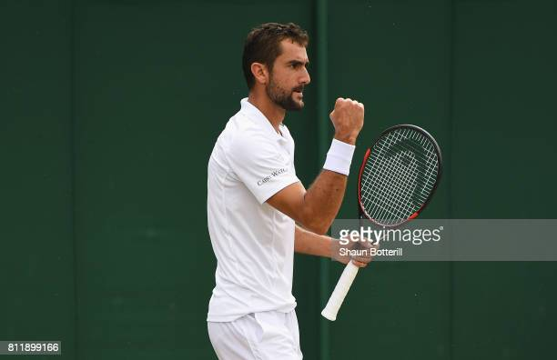 Marin Cilic of Croatia celebrates during the Gentlemen's Singles fourth round match against Roberto Bautista Agut of Spain on day seven of the...