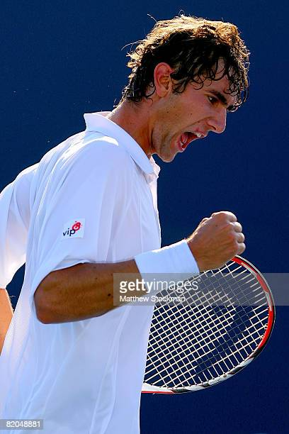 Marin Cilic of Croatia celebrates match point against Tommy Robredo of Spain during the Rogers Cup at the Rexall Centre at York University July 23...
