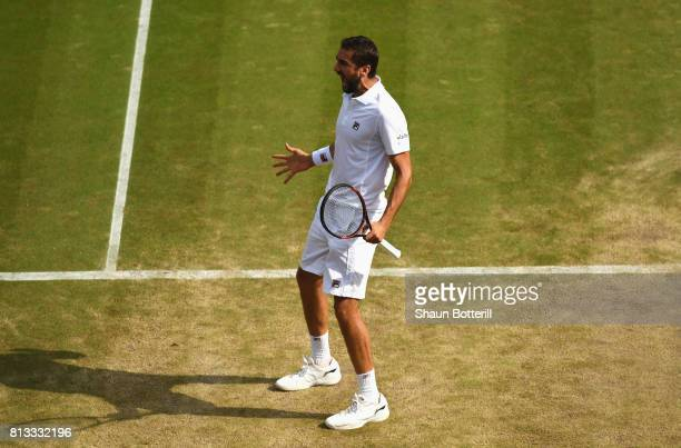 Marin Cilic of Croatia celebrates match point and victory during the Gentlemen's Singles quarter final match against Gilles Muller of Luxembourg on...