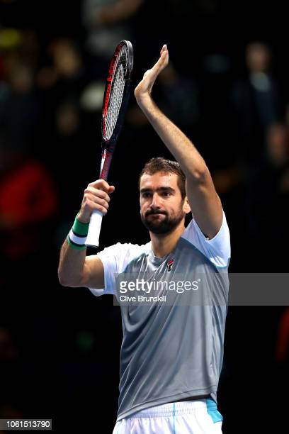Marin Cilic of Croatia celebrates match point during his singles round robin match against John Isner of The United States during Day Four of the...