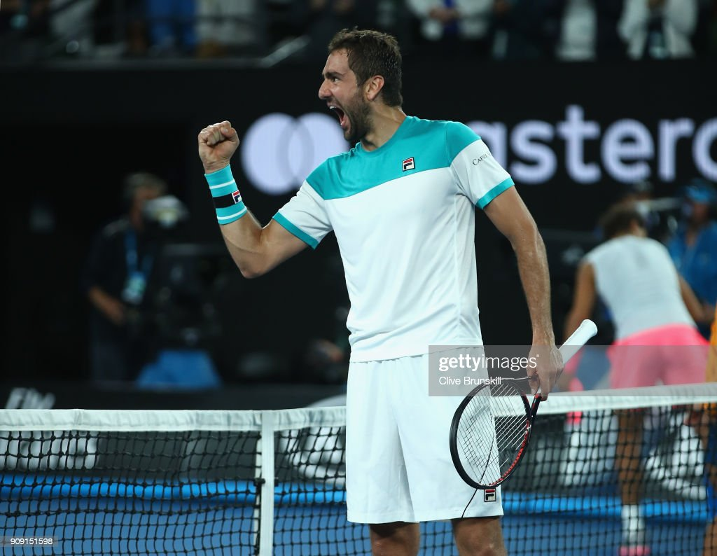 Marin Cilic of Croatia celebrates to his players box after victory in his quarter-final match against Rafael Nadal of Spain on day nine of the 2018 Australian Open at Melbourne Park on January 23, 2018 in Melbourne, Australia.