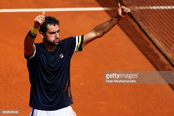 Marin Cilic of Croatia celebrates victory after winning his quarter final match against Pablo Carreno Busta of Spain during day 6 of the...