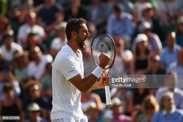 Marin Cilic of Croatia celebrates victory during the Gentlemen's Singles first round match against Philipp Kohlschreiber of Germany on day one of the...