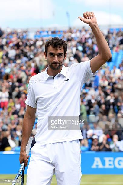 Marin Cilic of Croatia celebrates victory during the Men's Singles quarter final round match against Tomas Berdych of the Czech Republic on day five...