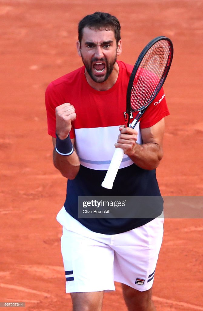 Marin Cilic of Croatia celebrates victory during the mens singles fourth round match against Fabio Fognini of Italy during day nine of the 2018 French Open at Roland Garros on June 4, 2018 in Paris, France.