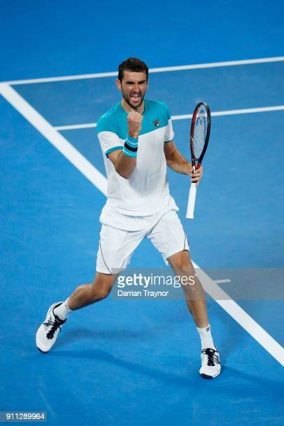 Marin Cilic of Croatia celebrates winning a break point in his men's singles final match against Roger Federer of Switzerland on day 14 of the 2018...