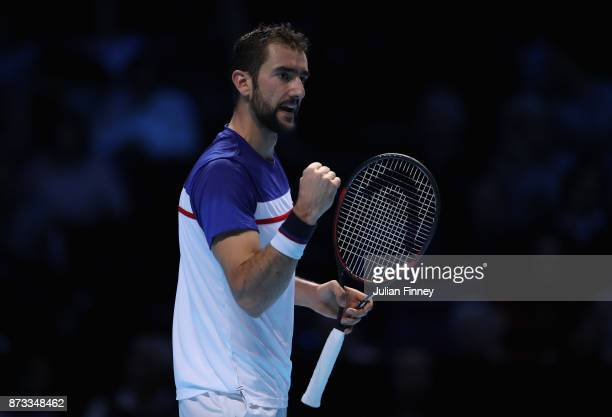 Marin Cilic of Croatia celebrates winning a game against Alexander Zverev of Germany during day one of the Nitto ATP World Tour Finals tennis at the...