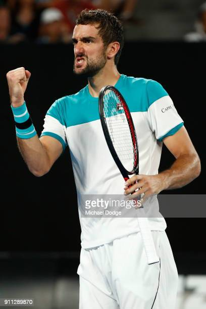 Marin Cilic of Croatia celebrates winning a point in his men's singles final match against Roger Federer of Switzerland on day 14 of the 2018...