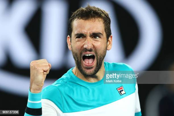 Marin Cilic of Croatia celebrates winning his quarterfinal match against Rafael Nadal of Spain on day nine of the 2018 Australian Open at Melbourne...