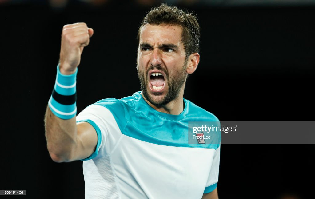 Marin Cilic of Croatia celebrates winning his quarter-final match against Rafael Nadal of Spain on day nine of the 2018 Australian Open at Melbourne Park on January 23, 2018 in Melbourne, Australia.