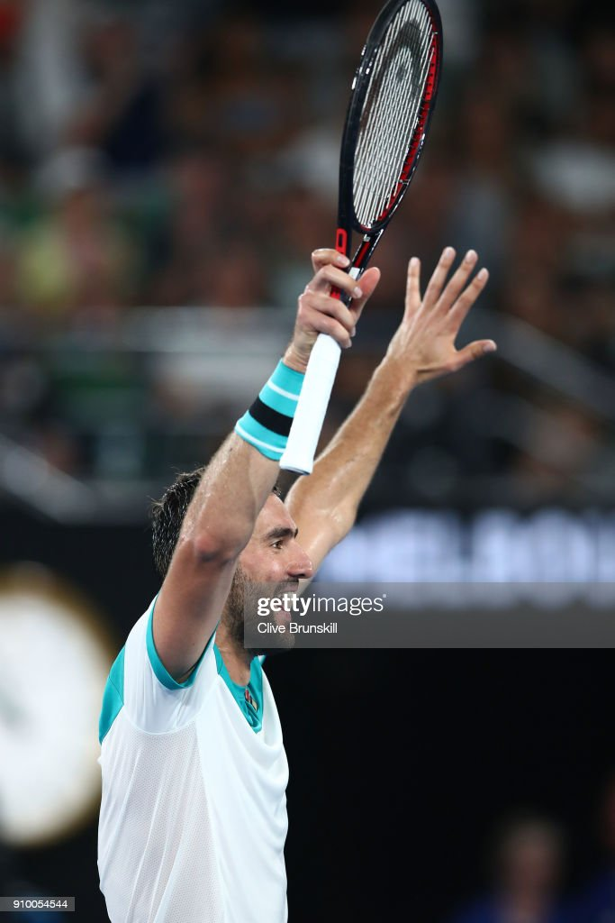 Marin Cilic of Croatia celebrates winning match point in his semi-final match against Kyle Edmund of Great Britain on day 11 of the 2018 Australian Open at Melbourne Park on January 25, 2018 in Melbourne, Australia.