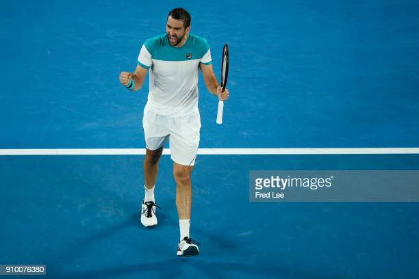 Marin Cilic of Croatia celebrates winning match point in his semifinal match against Kyle Edmund of Great Britain on day 11 of the 2018 Australian...