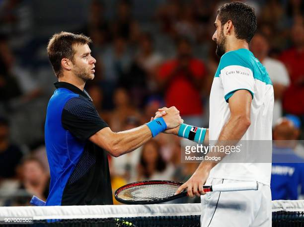 Marin Cilic of Croatia celebrates winning match point in his third round match against Ryan Harrison of the USA on day five of the 2018 Australian...