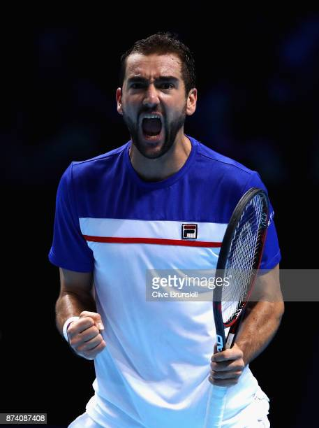 Marin Cilic of Croatia celebrates winning the 1st set during the singles match against Jack Sock of The United States on day three of the Nitto ATP...