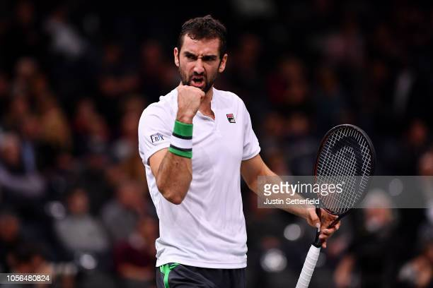 Marin Cilic of Croatia celebrates winning the first set during his Quarter Final match against Novak Djokovic of Serbia on Day 5 of the Rolex Paris...