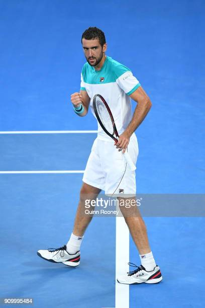 Marin Cilic of Croatia celebrates winning the first set in his semifinal match against Kyle Edmund of Great Britain on day 11 of the 2018 Australian...