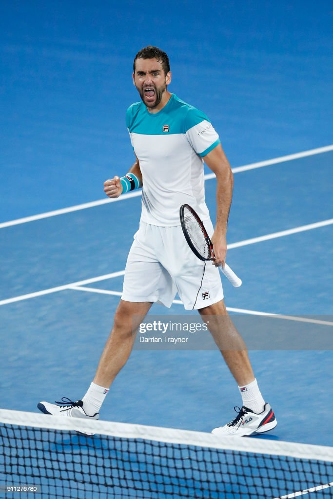Marin Cilic of Croatia celebrates winning the second set in his men's singles final match against Roger Federer of Switzerland on day 14 of the 2018 Australian Open at Melbourne Park on January 28, 2018 in Melbourne, Australia.