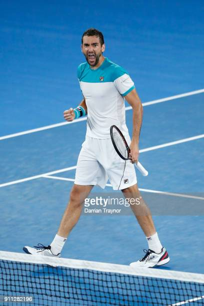 Marin Cilic of Croatia celebrates winning the second set in his men's singles final match against Roger Federer of Switzerland on day 14 of the 2018...