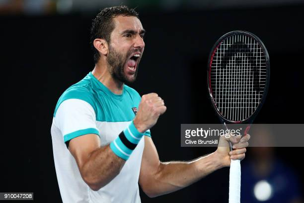 Marin Cilic of Croatia celebrates winning the second set in his semifinal match against Kyle Edmund of Great Britain on day 11 of the 2018 Australian...