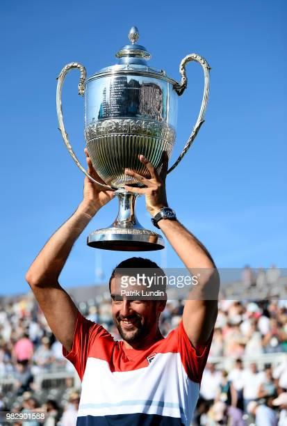 Marin Cilic of Croatia celebrates with the trophy after defeating Novak Djokovic of Serbia in the final of the the FeverTree Championships at Queens...