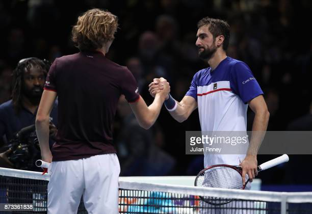Marin Cilic of Croatia congratulates Alexander Zverev of Germany after their match during day one of the Nitto ATP World Tour Finals tennis at the O2...