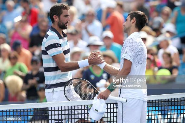 Marin Cilic of Croatia congratulates Novak Djokovic of Serbia during the Western Southern Open at Lindner Family Tennis Center on August 18 2018 in...