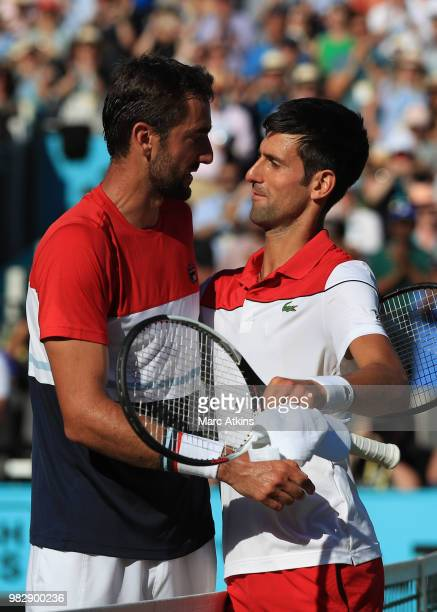 Marin Cilic of Croatia embraces Novak Djokovic of Serbia during Day 7 of the Fever-Tree Championships at Queens Club on June 24, 2018 in London,...