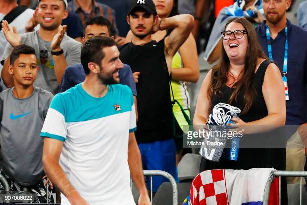 Marin Cilic of Croatia gives a fan his towel after he celebrates winning match point in his third round match against Ryan Harrison of the USA on day...