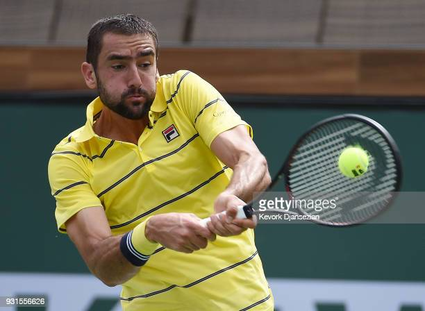Marin Cilic of Croatia hits a backhand against Philipp Kohlschreiber of Germany during Day 9 of BNP Paribas Open on March 13 2018 in Indian Wells...