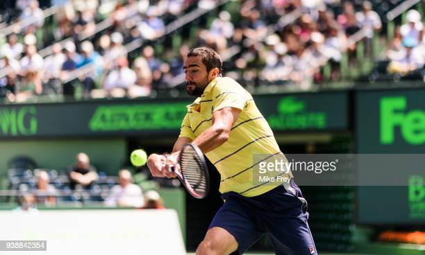 Marin Cilic of Croatia hits a backhand to John Isner of the USA during Day 9 of the Miami Open Presented by Itau at Crandon Park Tennis Center on...