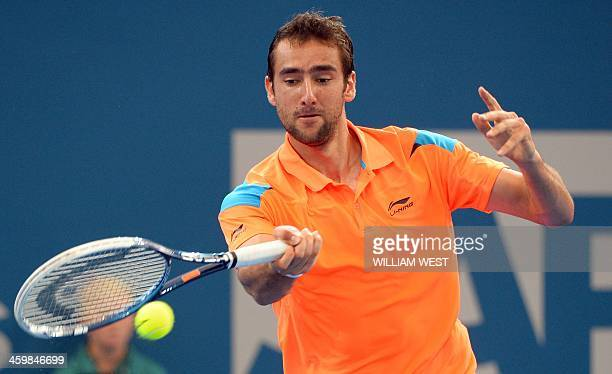 Marin Cilic of Croatia hits a forehand return during his victory over Grigor Dimitrov of Bulgaria at the Brisbane International tennis tournament in...