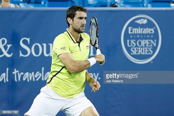 Marin Cilic of Croatia hits a return to Grigor Dimitrov of Bulgaria during a semifinal match on Day 8 of the Western Southern Open at the Lindner...